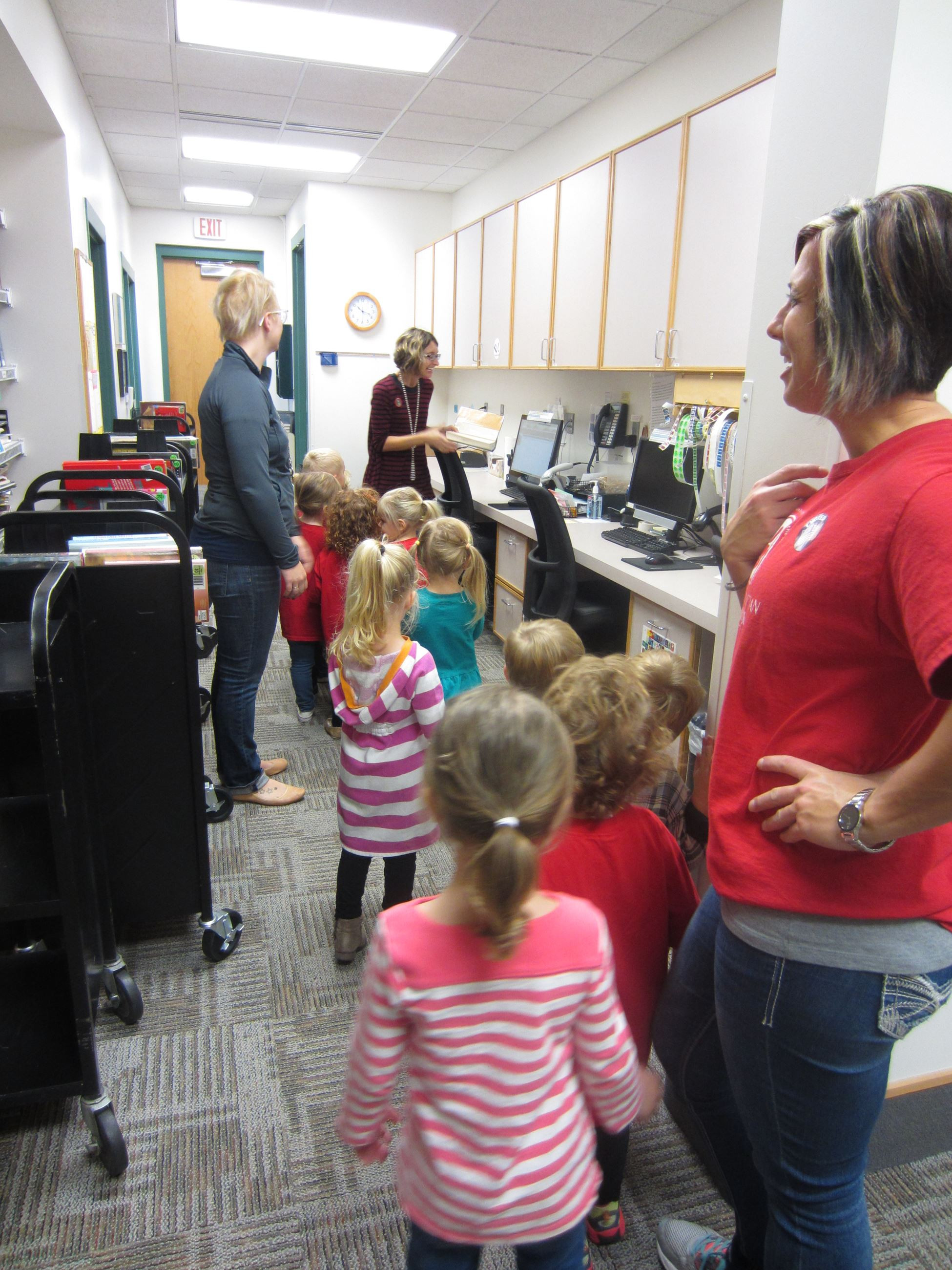Teddy Bear Field Trip showing students the backroom